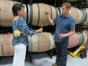 Jason Goelz discusses wine with Michelle McKay. Jason Stephens Winery recently purchased 378 acres. (Photo by Marty Cheek)