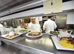 Executive Chef Tony Carcial puts the finishing touches on a meal.  (Photo courtesy Dan McCranie)