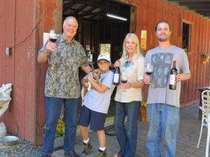 "Jerry Ross, his grandson Jerry, dog Maybell, Judy Ross and Jim Ross welcome visitors to their ""tasting barn."""