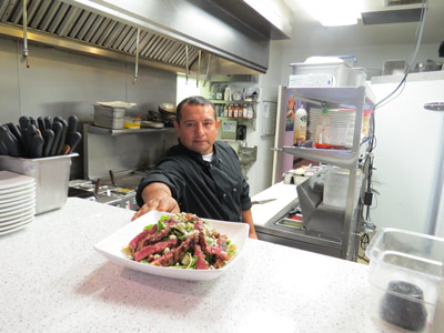 Executive Chef Adolfo Rojas presents a salad. Photo by Marty Cheek