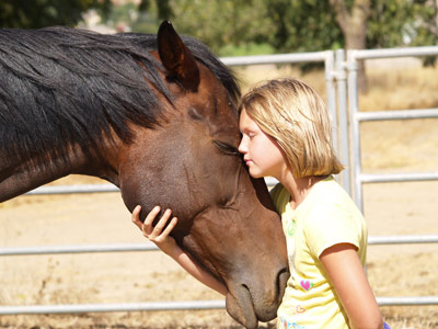 Photo by Jody Swift Volunteer Grace Swift and horse Jasmine at the Perfect Fit Equine Rescue facility.