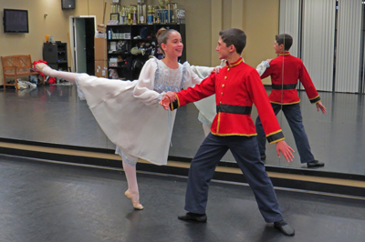 "Carolyn Chadbourne, 11, playing ""Clara,"" and Josh Escover, 13, playing the Nutcracker Prince, rehearse for the classic ballet ""The Nutcracker."""