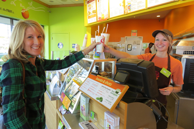Photo By Marty Cheek Jamba Juice Co Owner Katie Howard Accepts A Smoothie From Sarah