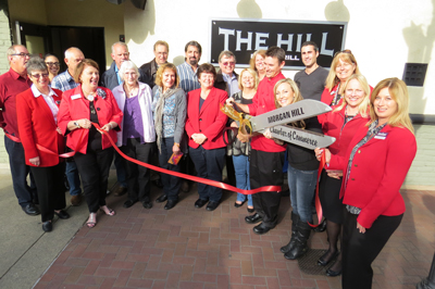 A split second after the ribbon was cut by The Hill Bar & Grill chef owner Dustin Evanger.