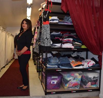 Photo by Robert Airoldi Cecelia Ponzini in Cecelia's Closet where needy can get free clothes.