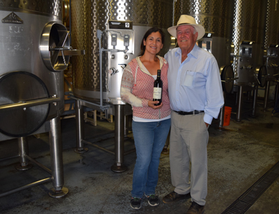 Photo by Robert Airoldi  Candace Ledesma, assistant tasting room manager, and Sycamore Creek Vineyards owner Bill Holt in the production area of the winery.