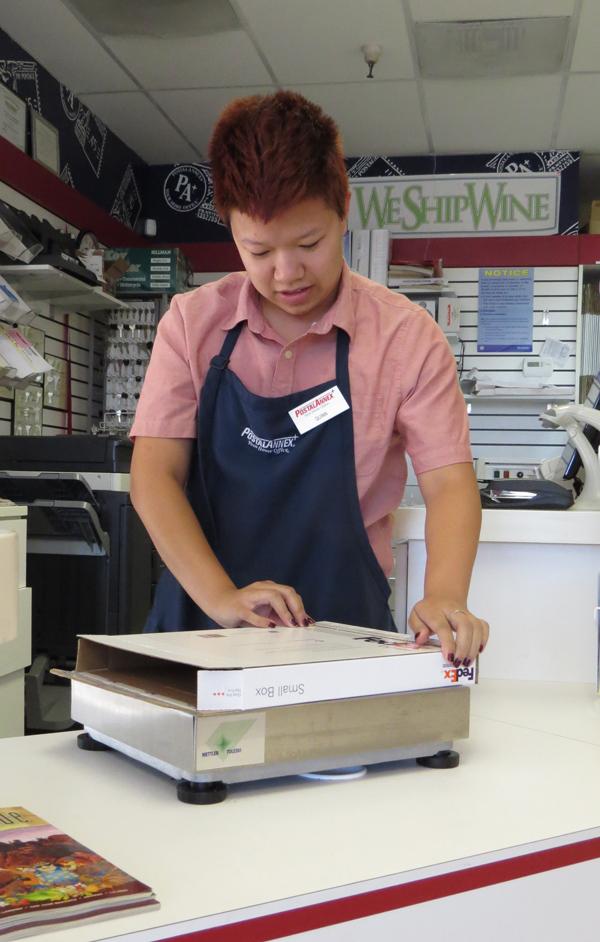 Photo by Marty Cheek Quinn Phan, a TeenForce participant, now works at Postal Annex.