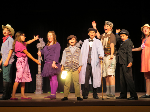 "Photo by Marty Cheek Children performers sing at Theater Fun's show ""Willy Wonka Jr."" in July."
