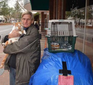 Photo by Robert Airoldi John Cary and his cat Sunshine cuddle in downtown Morgan Hill. Cary stays active doing odd jobs for downtown merchants.