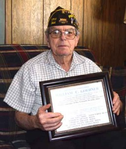 Photo by Robert Airoldi Bill Goehner, 89, a member of the Underwater Demolition Team during World War II, holds a list of his commendations.