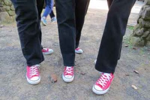Photo by Marty Cheek Volunteers adopted wearing  red and white Converse shoes in honor of Sierra who favored this type of footwear.