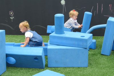 "Photo by Marty Cheek Children play with oversized foam blocks in the city's new ""pop-up park"" located on the former parking lot at the corner of Third and Monterey streets in downtown Morgan Hill."