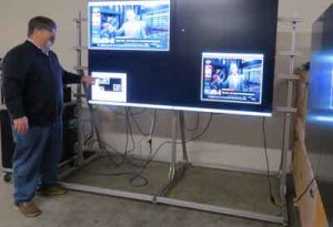 Photo by Marty Cheek Ron Vanderhorst shows a small video wall in his Morgan Hill facility.