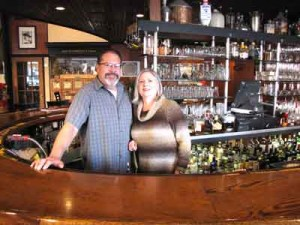 Co-owners Adam Sanchez and Ann Zyburra behind the bar at The Milias Restaurant. Photo by Lauren Newcomb