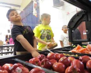Photo by Marty Cheek Students at San Martin/Gwinn Elementary School select healthy foods at the new salad bar.
