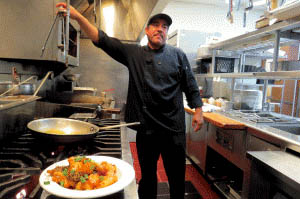 Photo by Marty Cheek Chef Lucio Telles in the kitchen at Coyote Creek Bar and Grill is currently upgrading the menu.