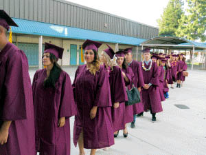 Photo by Marty Cheek Morgan Hill Community Adult School graduates head toward the Live Oak High School theater for this year's commencement ceremony.