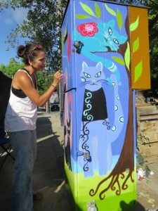 Photo by Marty Cheek Lina paints cats on a utility box in downtown Morgan Hill.