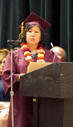 Photo by Kimberly Beare Graduate Rosemary Carranza addresses the audience.