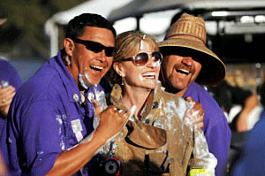 Photo courtesy Gilroy Garlic Festival Association board members from left, Randy Wong, Deanna Franklin and Jim Buessing have a laugh during last year's Garlic Festival.