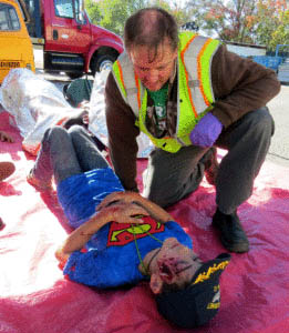 "Photo by Marty Cheek A Morgan Hill CERT student checks on a volunteer ""victim"" for injuries in a major earthquake emergency simulation."