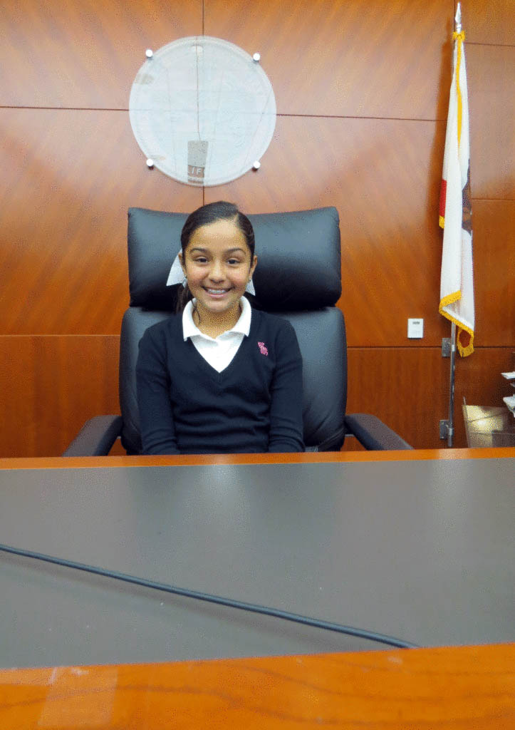 Photo by Marty Cheek  San Martin Gwinn student Alondra Sanchez sits in a judge's chair on a visit to the South County Courthouse.