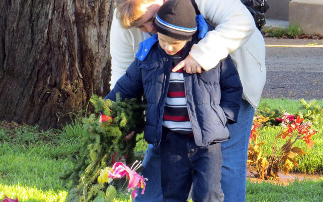 Residents honor deceased veterans at Wreaths Across America event