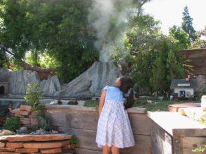 Photo Courtesy Garden Railroad Association A Young Girl Examines A Steaming  Model Volcano As Part Of A Backyard Garden Railroad.